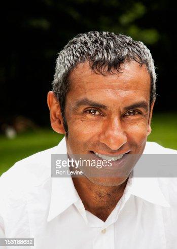 Mature Indian man, smiling : Stock Photo