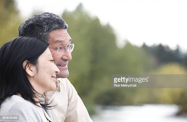 Mature Japanese couple in nature.