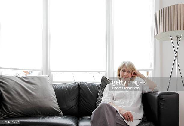 Mature lady sitting on a sofa