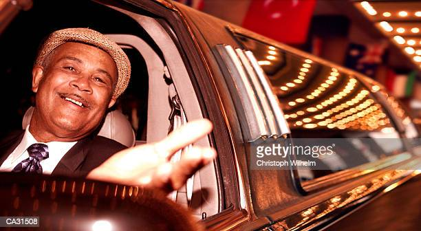 Mature limousine driver smiling, close-up, night