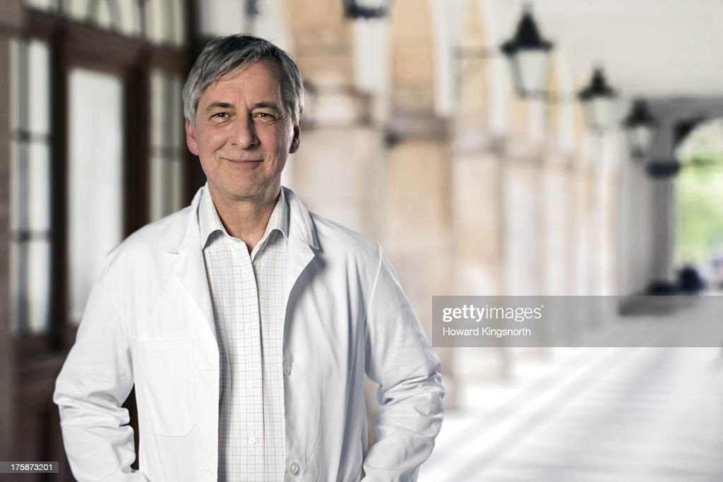 mature male doctor standing : Stock Photo
