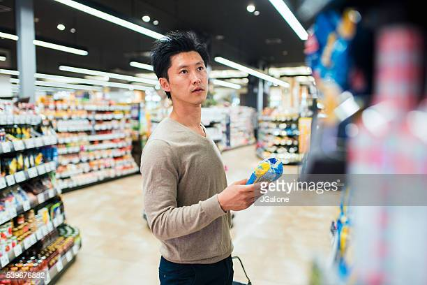 Mature male grocery shopping