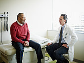 Mature male patient in discussion with doctor
