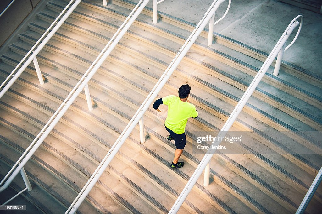 Mature male runner training on steps