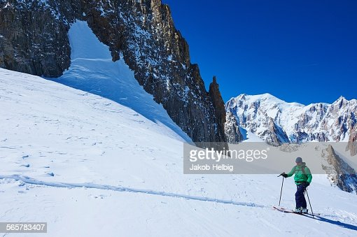 Mature male skier moving up Mont Blanc massif, Graian Alps, France