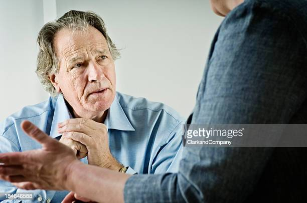 Mature Male talking To a Counsellor