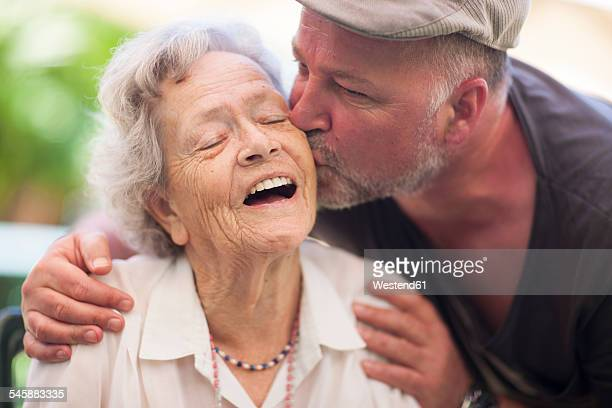 Mature man and happy senior woman outdoors