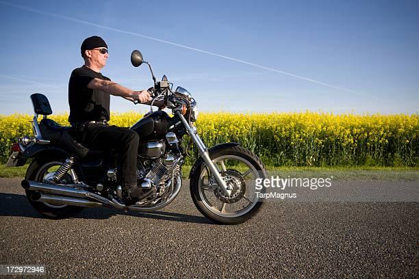 Mature man and his bike