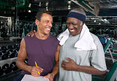 Mature man and senior man in gym, smiling