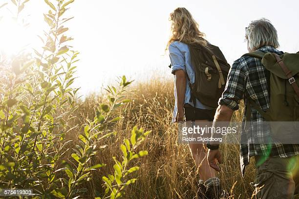 Mature Man and Woman with rucksacks hiking