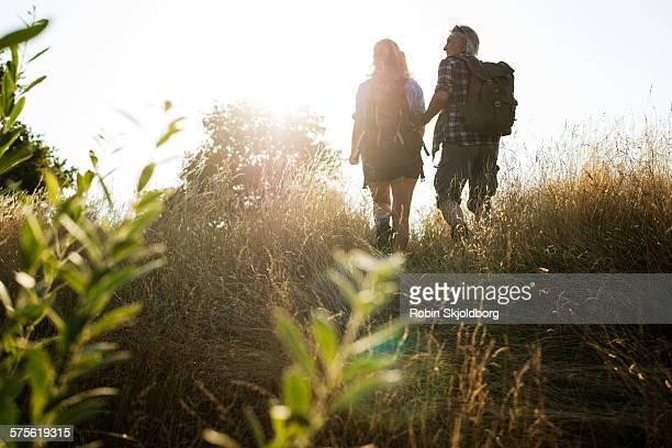 Mature Man and Woman with rucksacks hiking