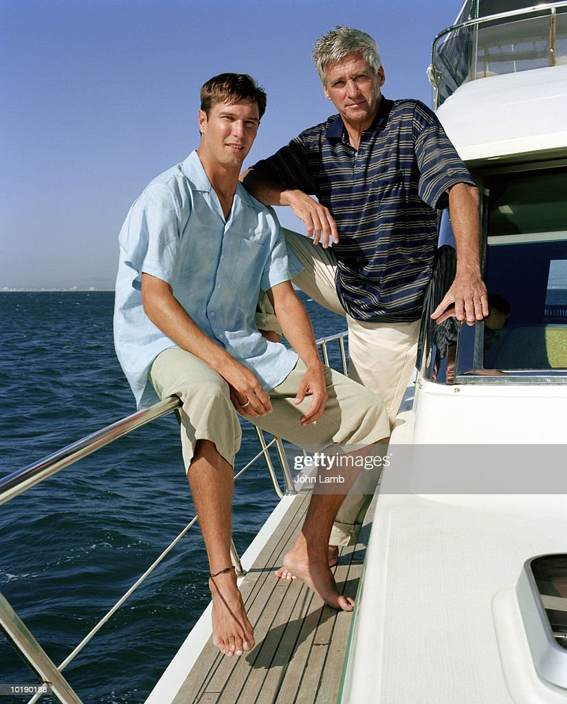 Mature man and young man on boat, portrait : Stock Photo