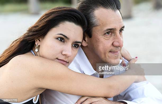 Mature man and young woman