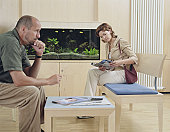 Mature man and young woman sitting in waiting room