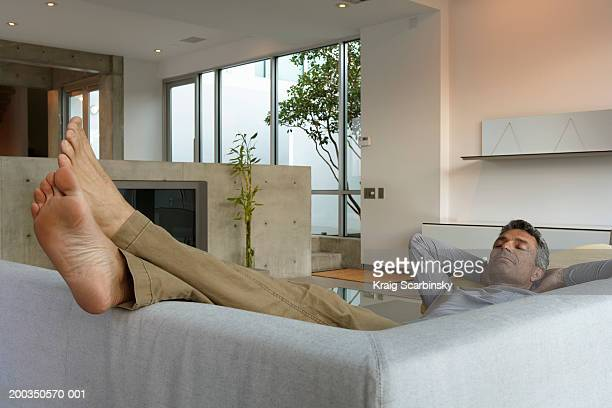 Mature man asleep on couch