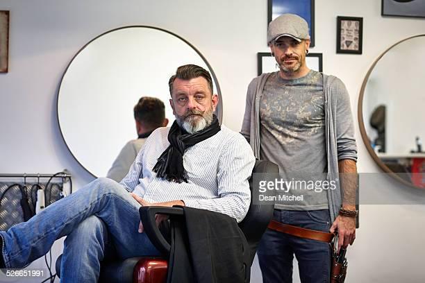 Mature man at barber shop with hairdresser