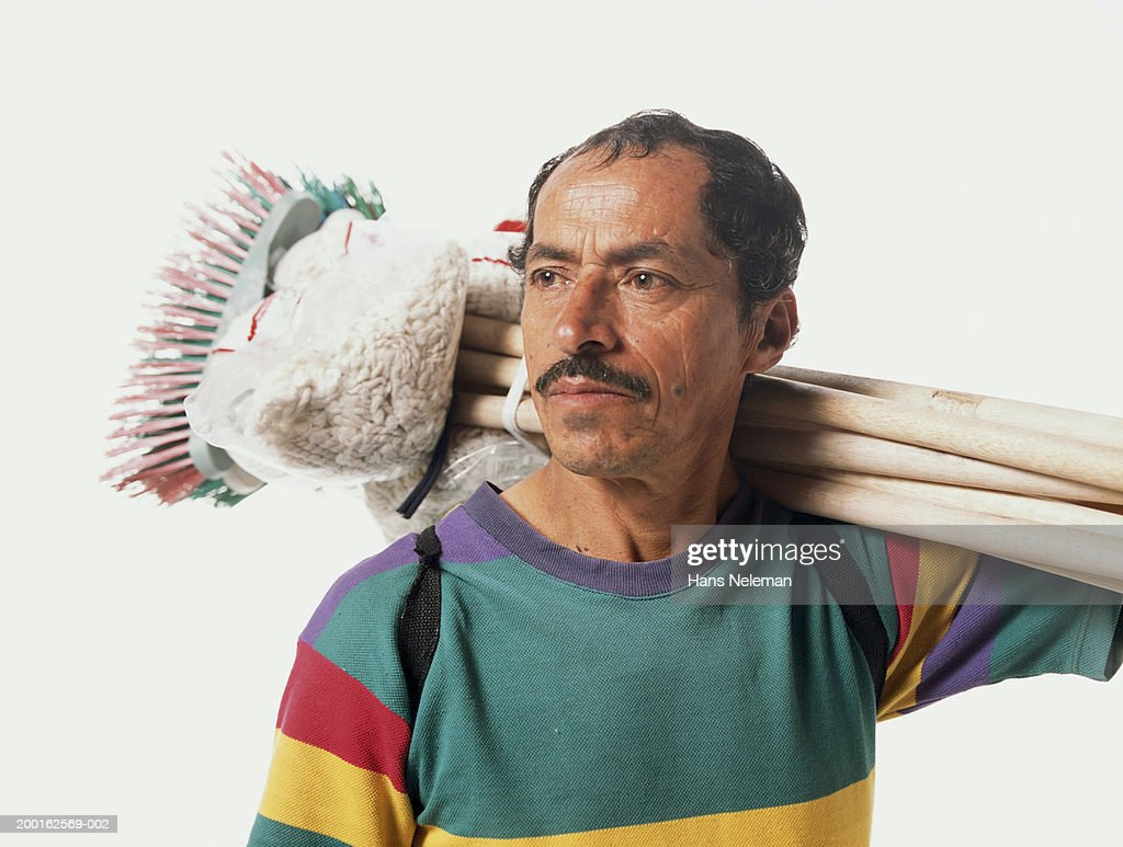 Mature man carrying tools : Stock Photo