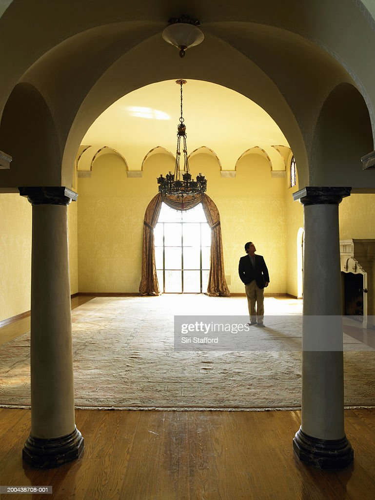Mature man checking room in luxury home : Stock Photo