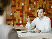 Mature man communicating in meeting
