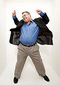 Mature man dancing in studio, high angle view