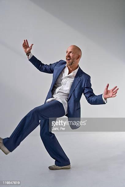 Mature man dancing, smiling
