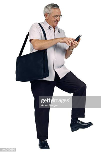 Mature Man Dialing Mobile Phone