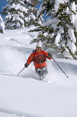 Mature man downhill skiing, low angle view