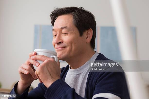 Mature man drinking coffee