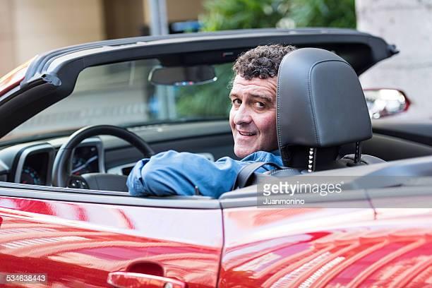 Mature man driving his convertible car