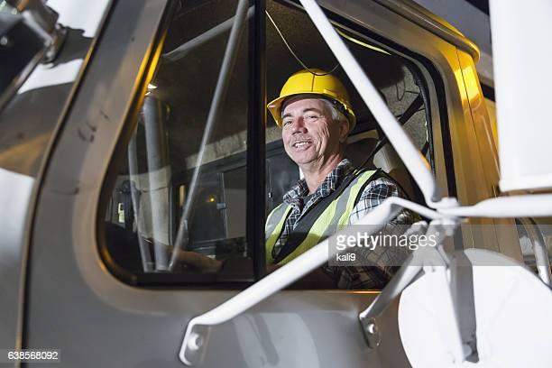 Mature man driving truck