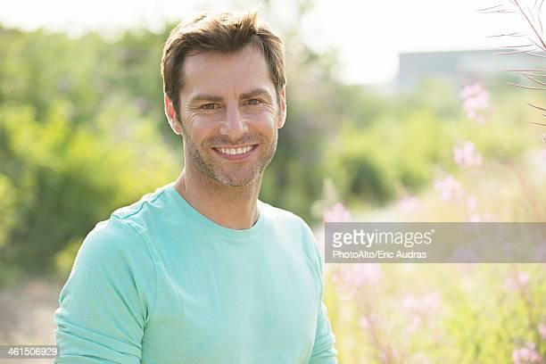 Mature man enjoying outdoors, portrait