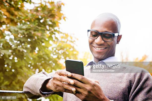 Mature man enjoying social networking on mobile phone