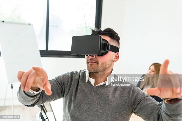 mature man entartains his self with virtual reality device simulator