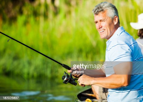 Mature Man Fishing From a Boat