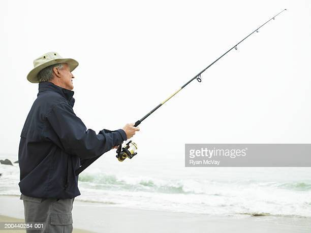 Mature man fishing on beach