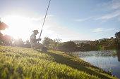 Mature man fishing on peaceful riverbank