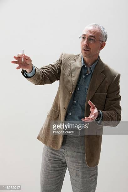 Mature man gesturing, studio shot