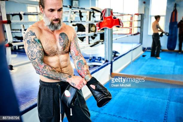 Mature man getting ready for kickboxing practice