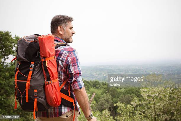 Mature man hiking in the forest.