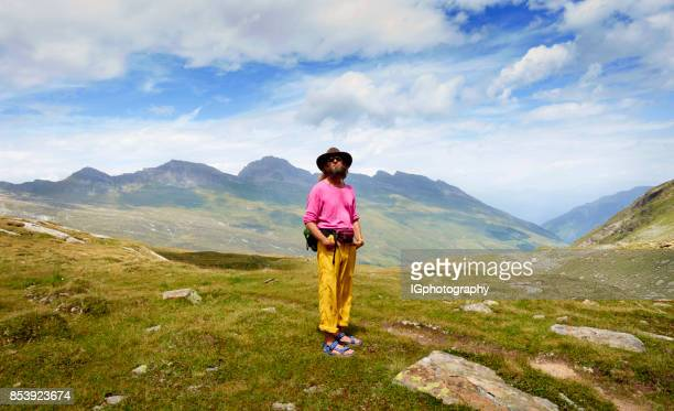 Mature Man hiking the Swiss Alps in Summer