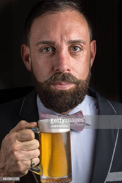 Mature man Holding a Beer