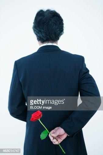 Mature Man Holding A Rose