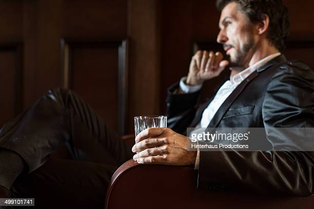 Mature Man Holding Whiskey Glass