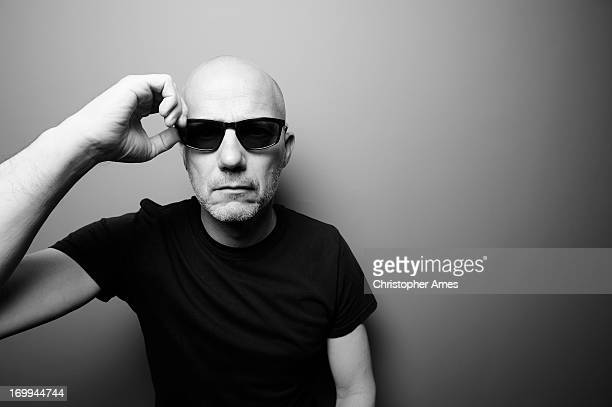 Mature Man in Black T-Shirt with Sunglasses