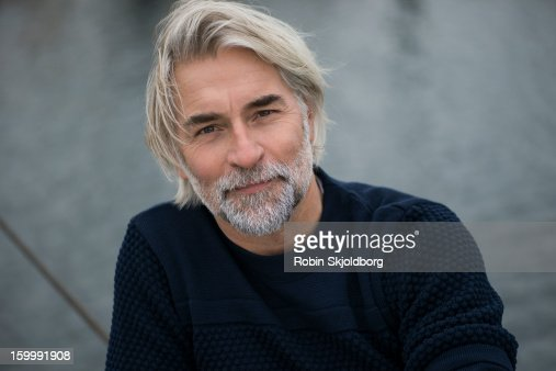 Mature man in blue sweater : Stock Photo