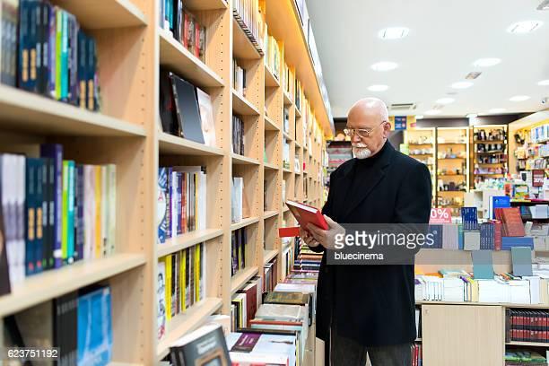 Mature man in bookstore
