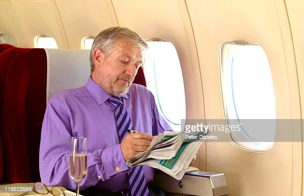 Mature man in business class on airplane