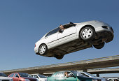 Mature man in car in air above people in traffic jam