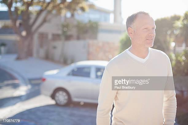 Mature man in driveway