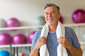 Mature man doing fitness exercises